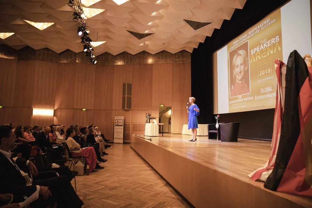 Sue speaking on stage in Nürnberg
